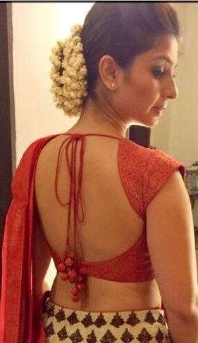 Tanisha in classic backless blouse. | Sleeveless blouse designs .