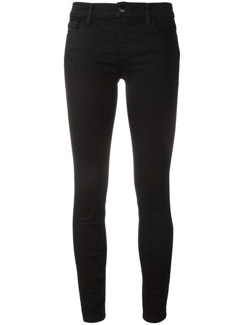Mid-High rise black skinny jeans or twill pants Example: J Brand .