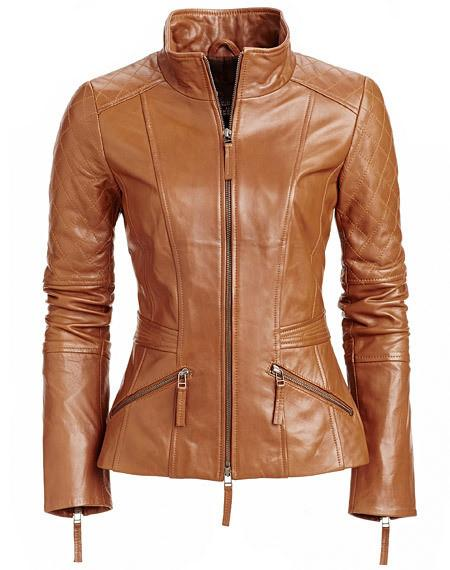 Women's stylish tan brown leather jacket with quilted patches .