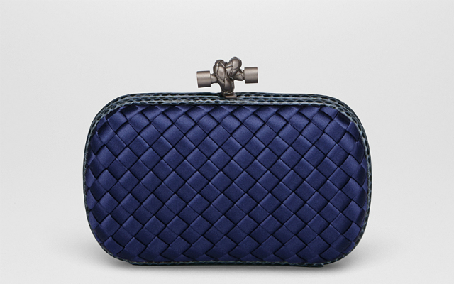 8 classic designer clutch bags that will never go out of style .