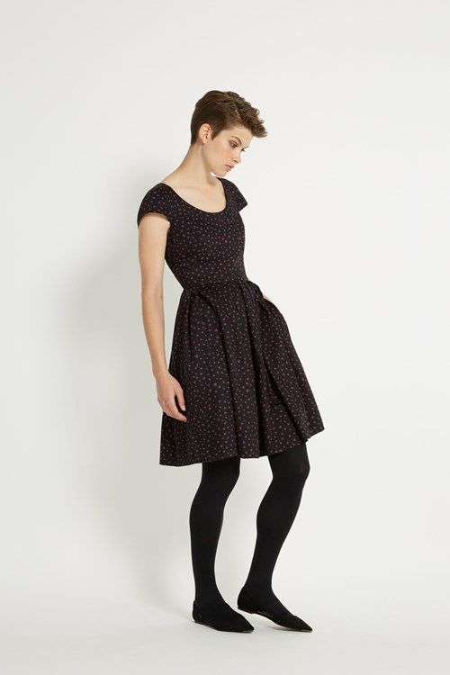 Scoop neck dress with short-sleeves and flared skirt. Wear this .