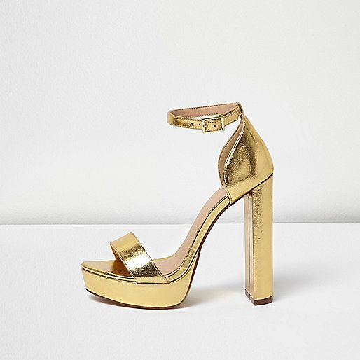 Gold metallic upper Double strap design Buckled ankle strap .
