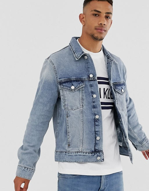 Calvin Klein Jeans denim trucker jacket in mid wash | AS