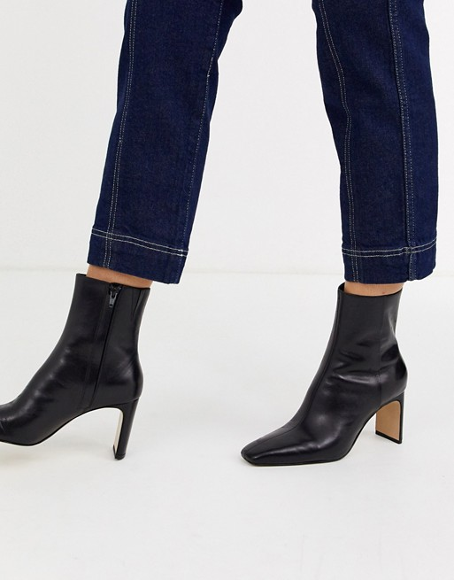 & Other Stories leather almond toe high heel ankle boots in black .