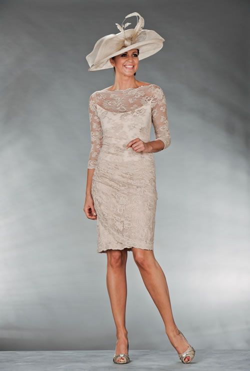 Mother Of The Bride / Groom Outfit: Knee length cream lace dress .