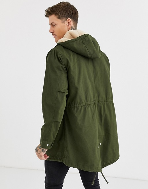 ASOS DESIGN parka jacket in khaki with detachable faux fur liner .