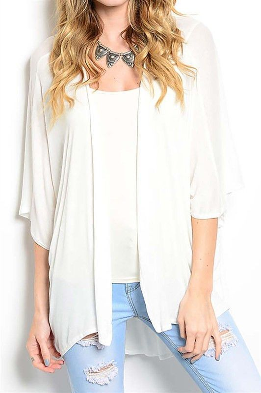 Our White Draped Short Sleeve Cardigan is 97% RAYON 3% SPANDEX .