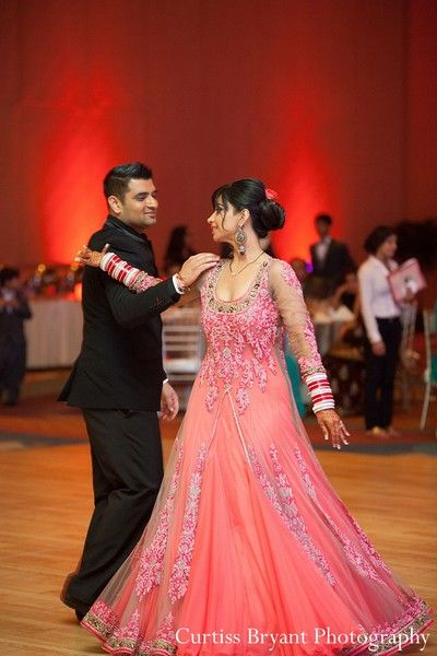 This bride and groom celebrate at their Indian wedding reception .