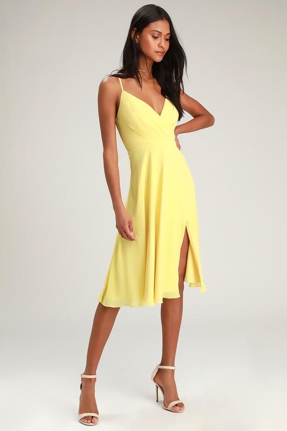 Maribelle Pale Yellow Surplice Midi Dress | Yellow midi dress .